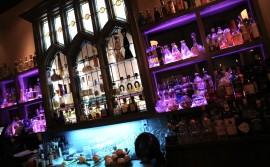 Premium tequila bottles line the back bar at Reposado Toronto.