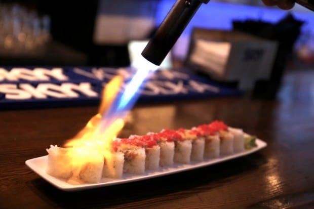 Torching sushi at Hapa Izakaya Toronto.