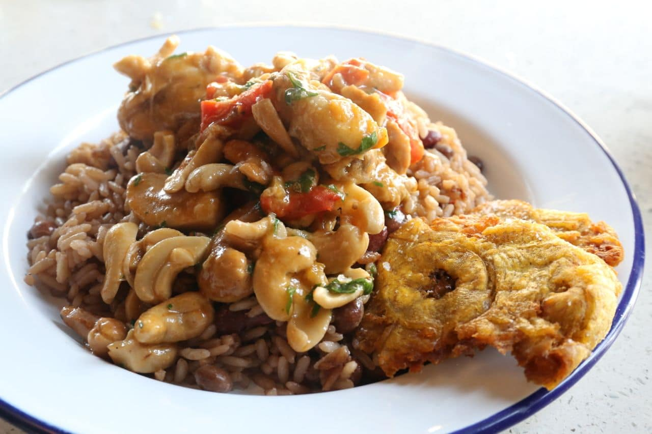 Cashew Chicken with Rice and Beans at Rhum Corner.