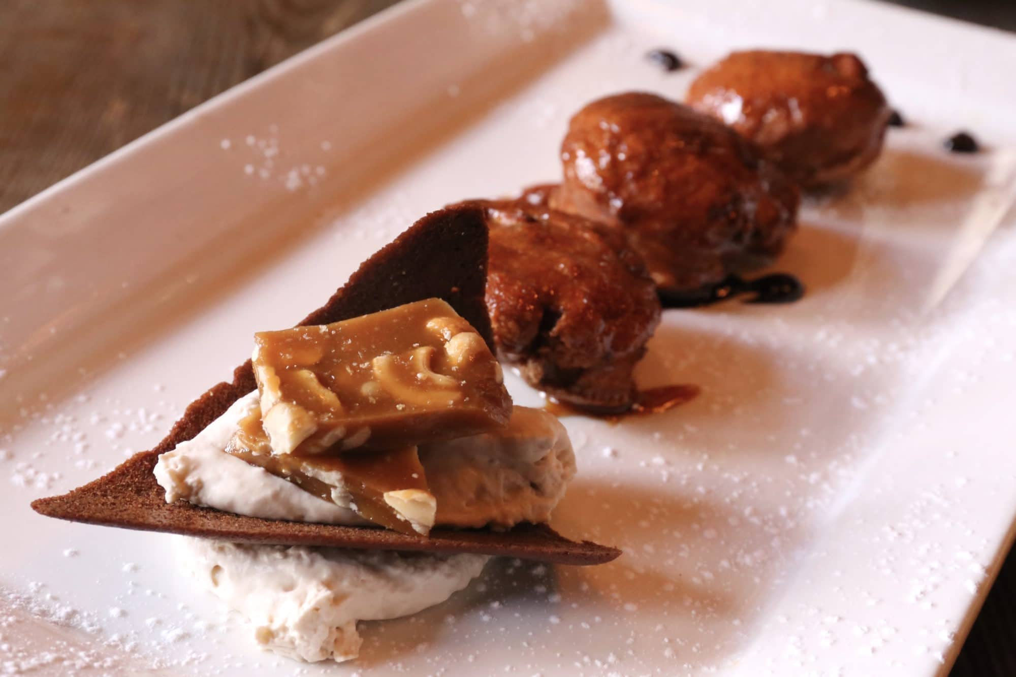 Abe Erb Waterloo: Apple Fritters with cider glaze, tuile cookie, whipped cream and chocolate sauce