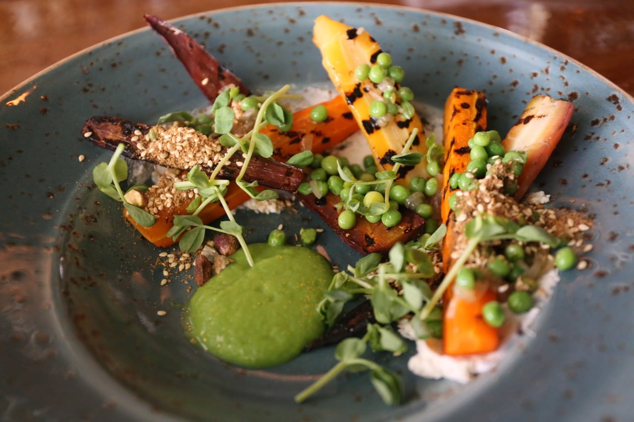Grilled Carrot Salad with whipped goat cheese, peas and dukha.