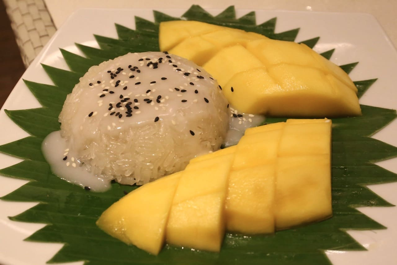 Mango Sticky Rice Is A Thai Dessert Made With Glutinous Rice Fresh Mango And Coconut Milk Best Enjoyed While Basking On The Beach