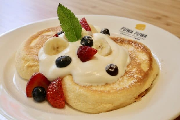Fuwa Fuwa Signature Pancake is topped with strawberry, blueberry and banana.