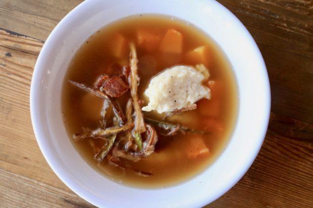 Italian Dumplings floating in a leek, bacon and squash soup.
