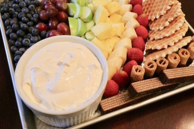Marshmallow Fluff Fruit Dip served with fresh fruit and wafer cookies.