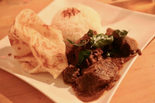 Soos Toronto serves a plate of hearty Beef Rendang with rice and roti.