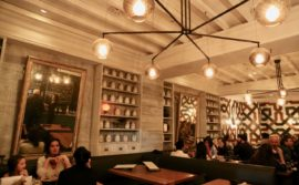 An intimate and glowing dining room at Tabule Toronto.