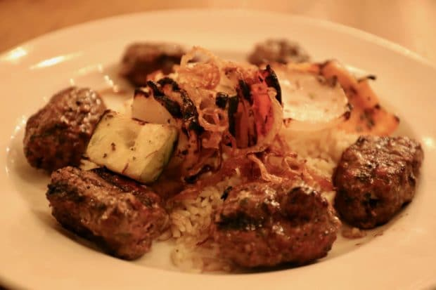 Lamb and beef Kefta with roasted vegetables and rice.