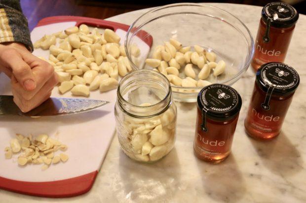 Crushing raw garlic is the first step in making fermented garlic honey.