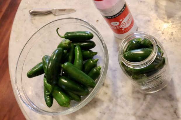 Ingredients you'll need to prepare fermented jalapeno peppers.