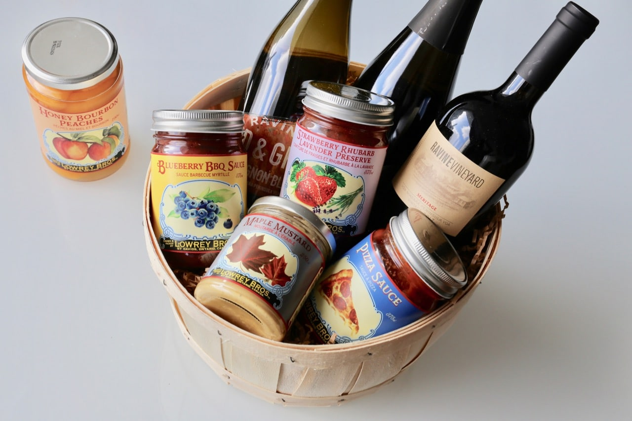 Ravine Vineyard's gift basket filled with wine and preserves.