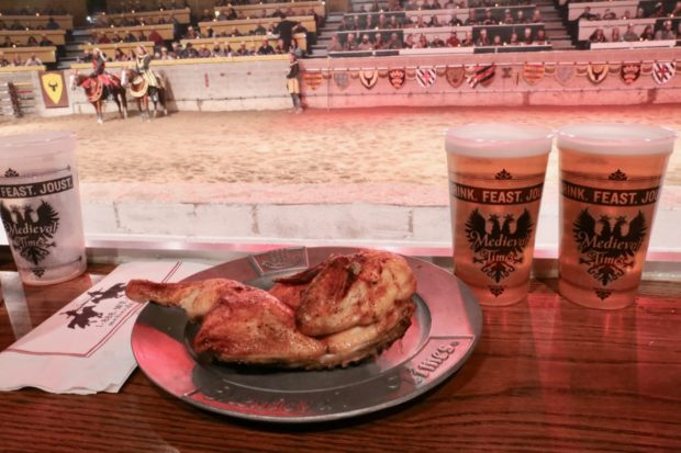 Eating a half roasted chicken with your hands slurping beer at Medieval Times Toronto.