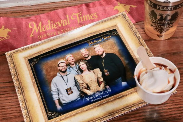 A framed portrait with the Queen at Medieval Times Toronto.