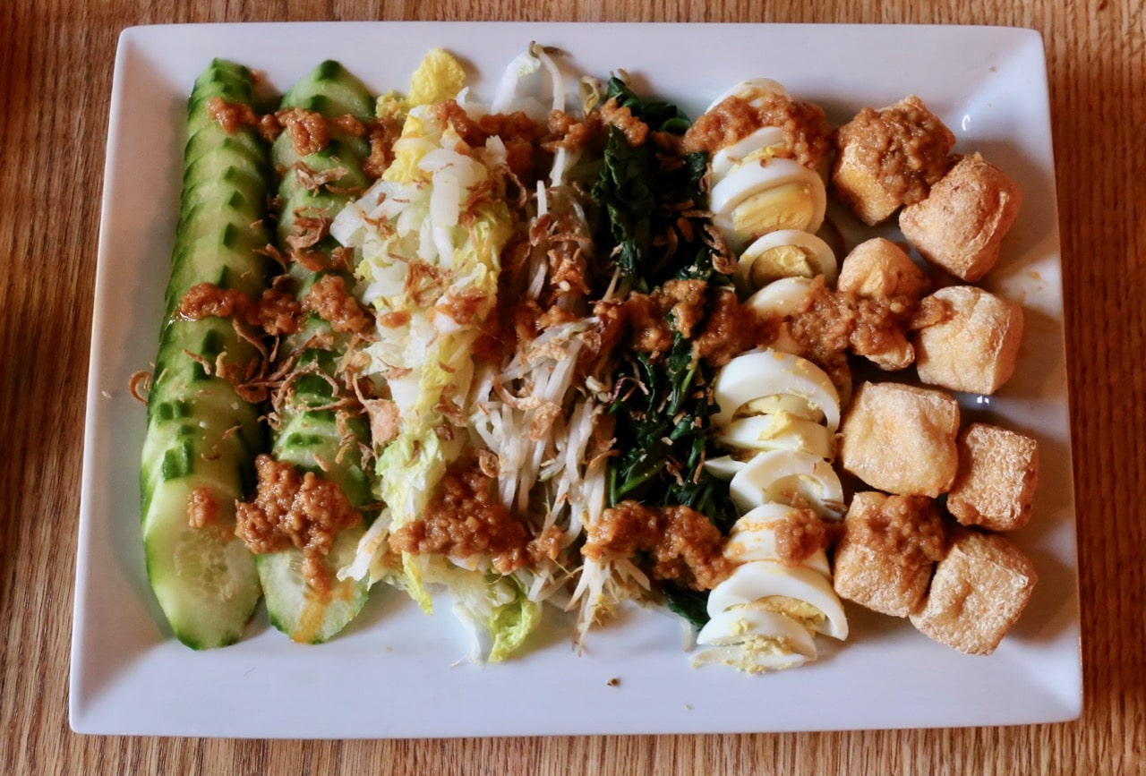 Toronto Indonesian restaurant classic, Gado Gado salad featuring blanched vegetables and peanut sauce.