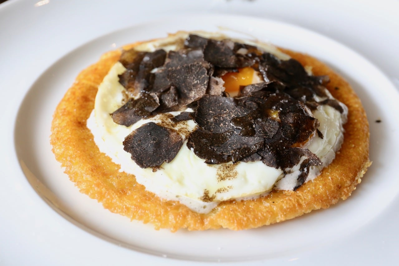 Buca Yorkville's brunch features Italian chickpea crepes with black truffle and fried egg.