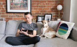 Toronto illustrator Mark Scheibmayr drawing with his iPad Pro and dog.