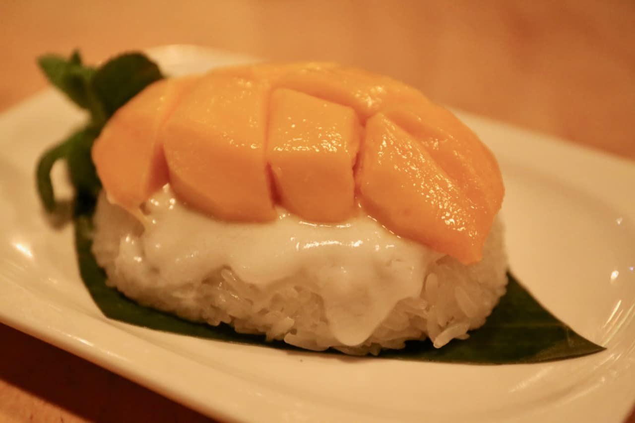 Mango and coconut sticky rice is a classic Thai dessert.