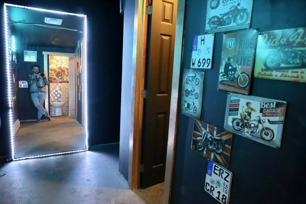 Step downstairs and you'll find bathrooms covered in Playboy pinups and vintage motorcycle magazines.