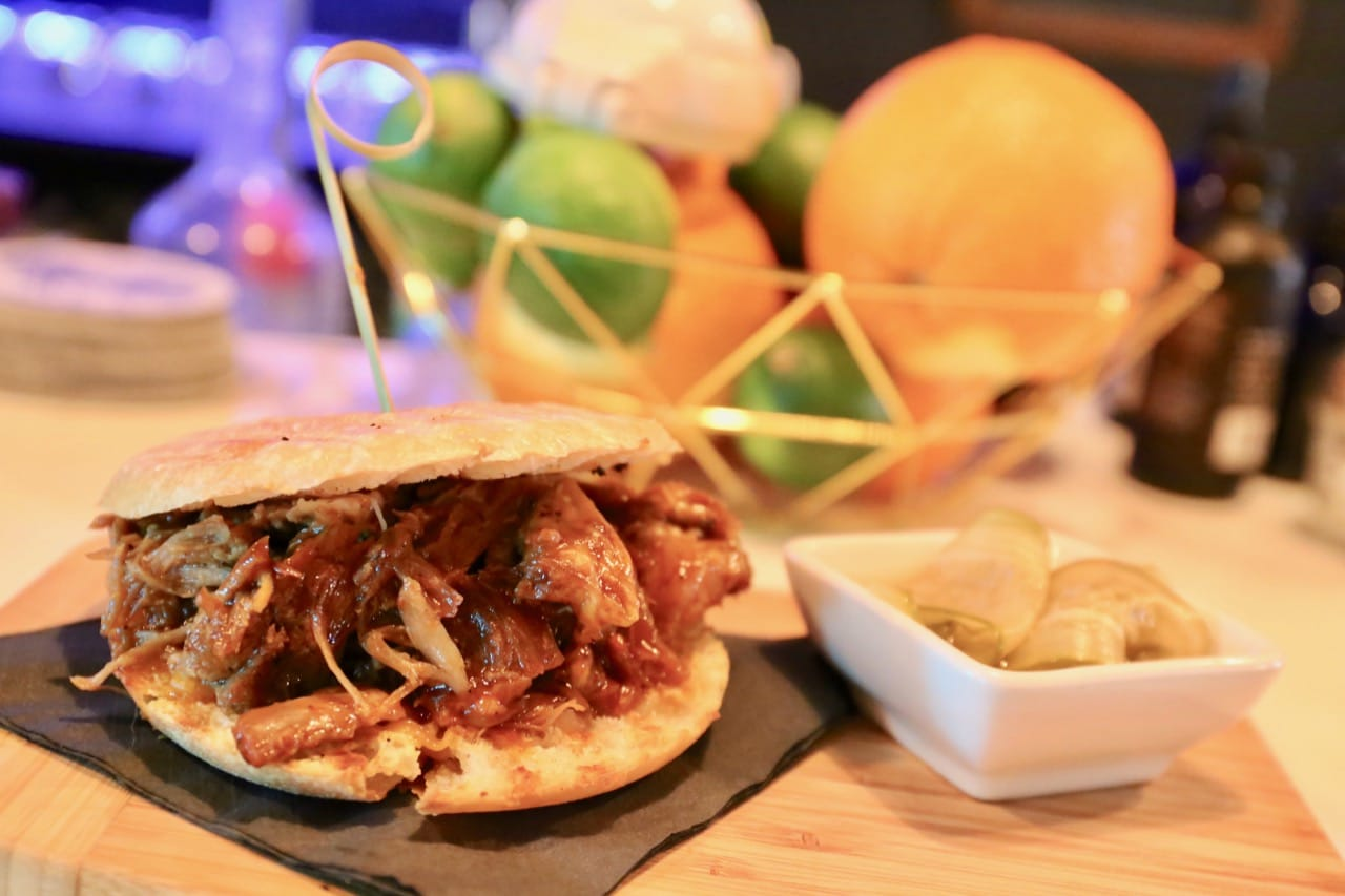 Pulled Pork Sandwich with house made pickles.