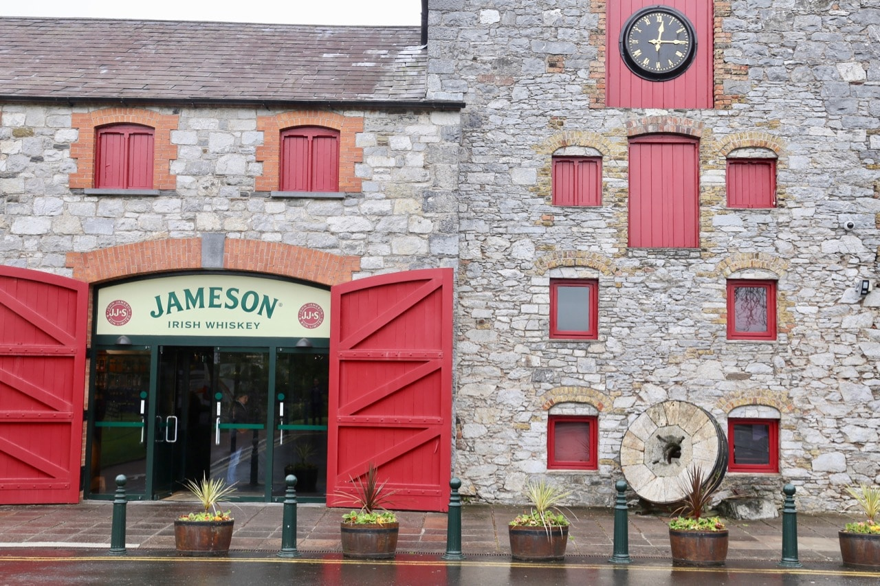 Skip through the big red doors for your Jameson Distillery Tour.