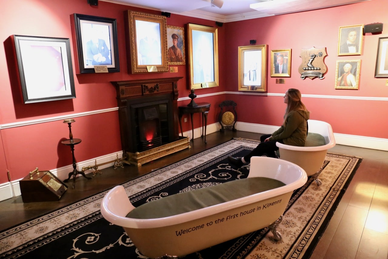 Sit in a bathtub while talking portraits share the Irish brewery's unique history.