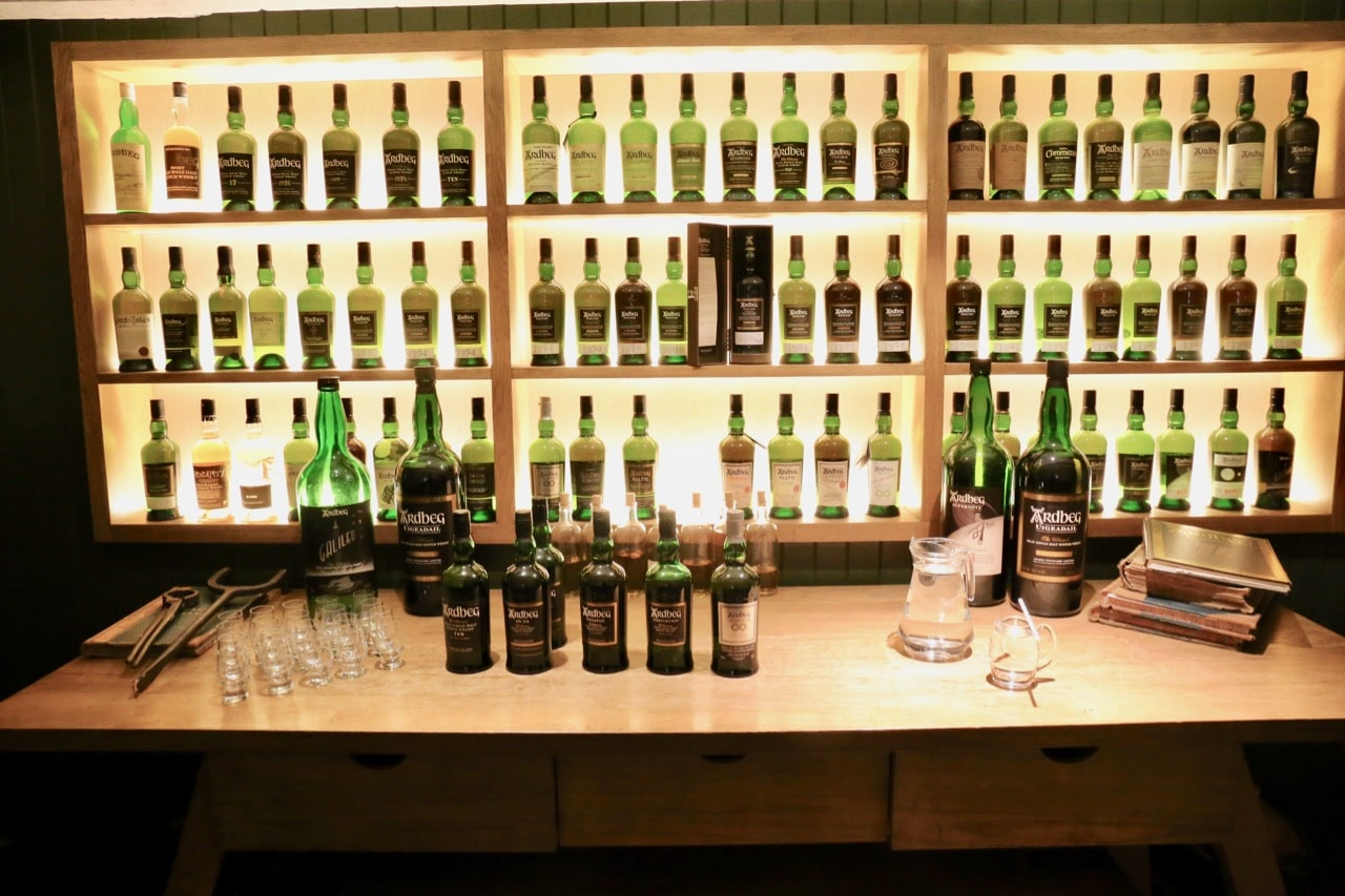 Single malt aficionados love touring through Ardbeg's historic whisky bottle collection.