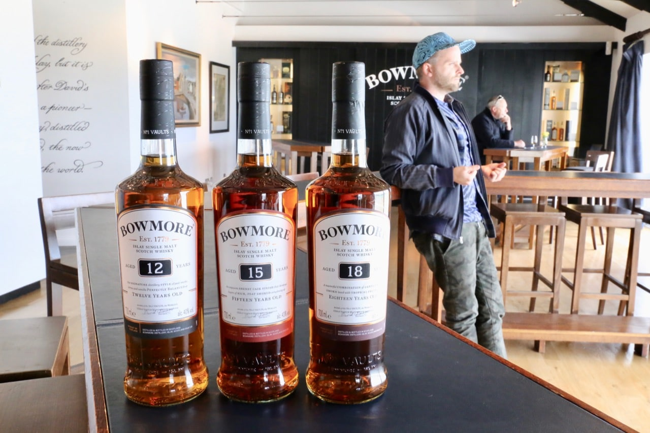 Enjoying a single malt whisky tasting at Bowmore Distillery's tasting room.