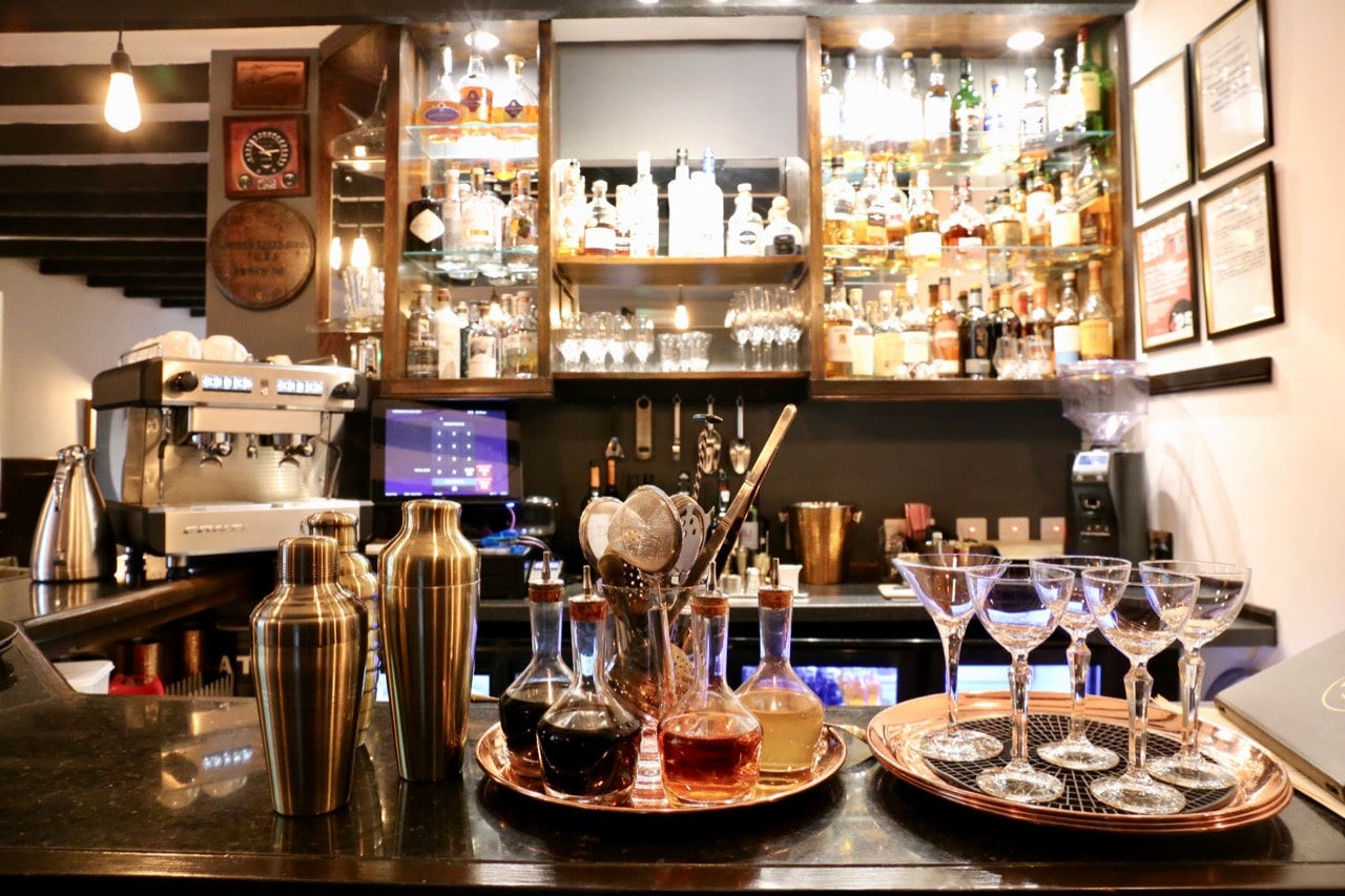 Arrive early for dinner to enjoy a craft cocktail at Edinbane Lodge's cozy bar.