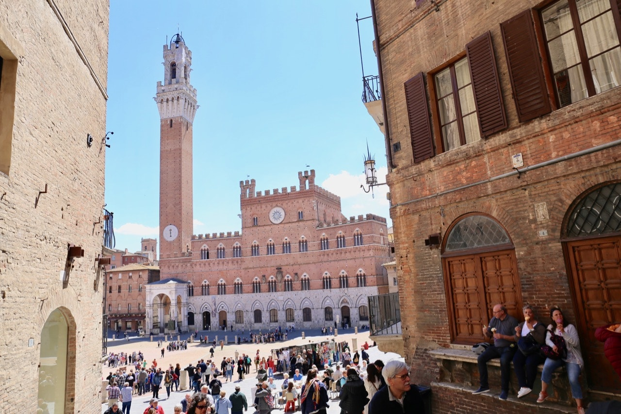 One of the best things to do in Siena on a sunny day is enjoy a stroll of Piazza del Campo.