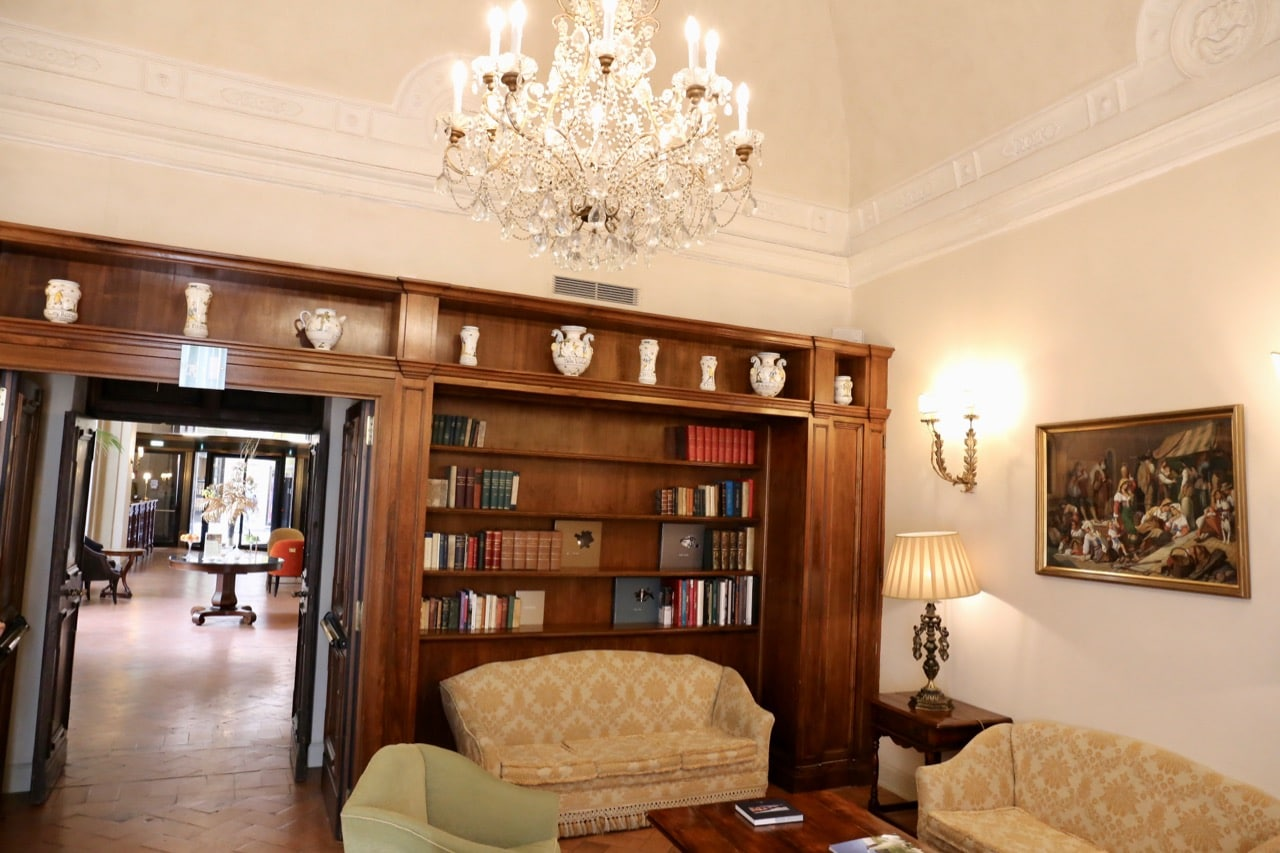 The cozy library at Grand Hotel Continental Siena.