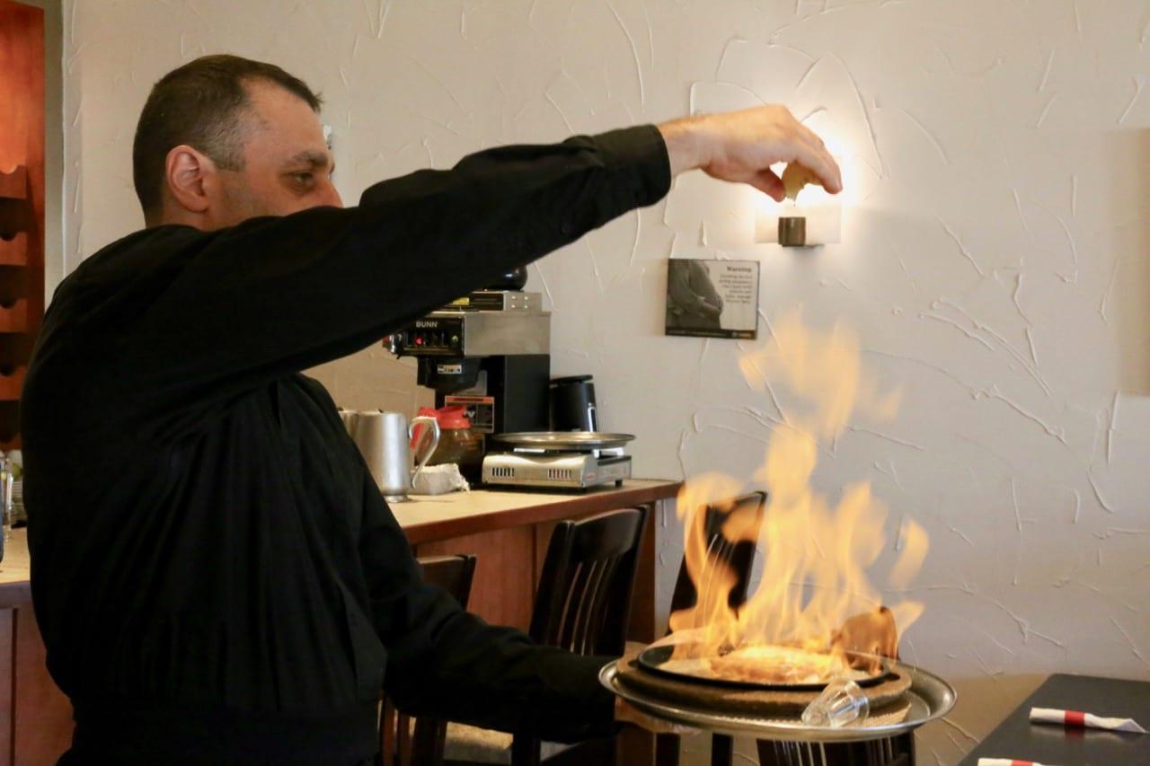 Saganaki Oppa is kefalotyri cheese set on fire at the table with ouzo.