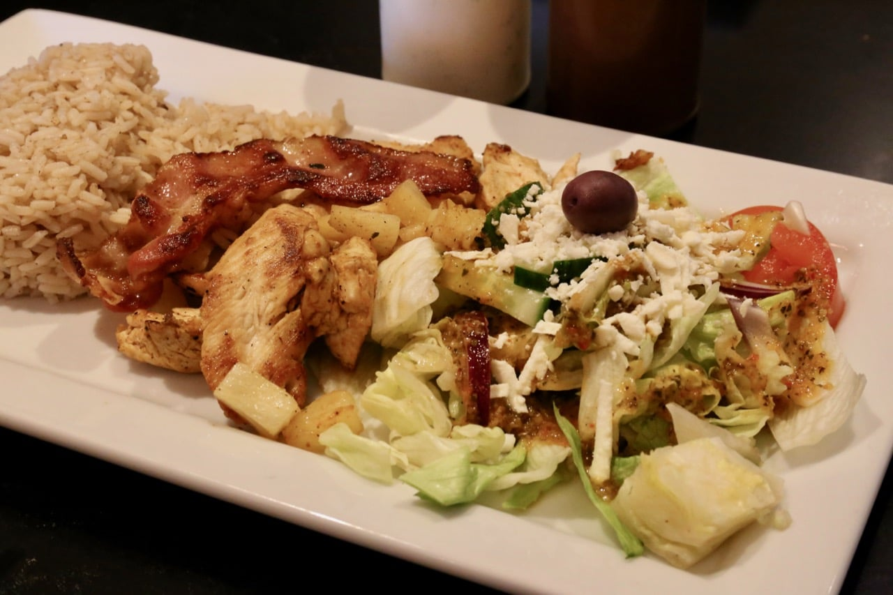 Chicken Pineapple is served with crispy bacon and a Greek salad.