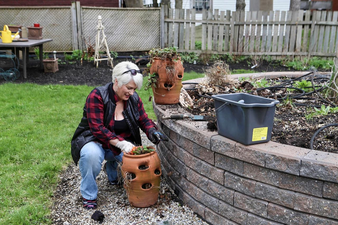 Theresa prepping a planter for summer strawberries at her Stratford Bed and Breakfast.