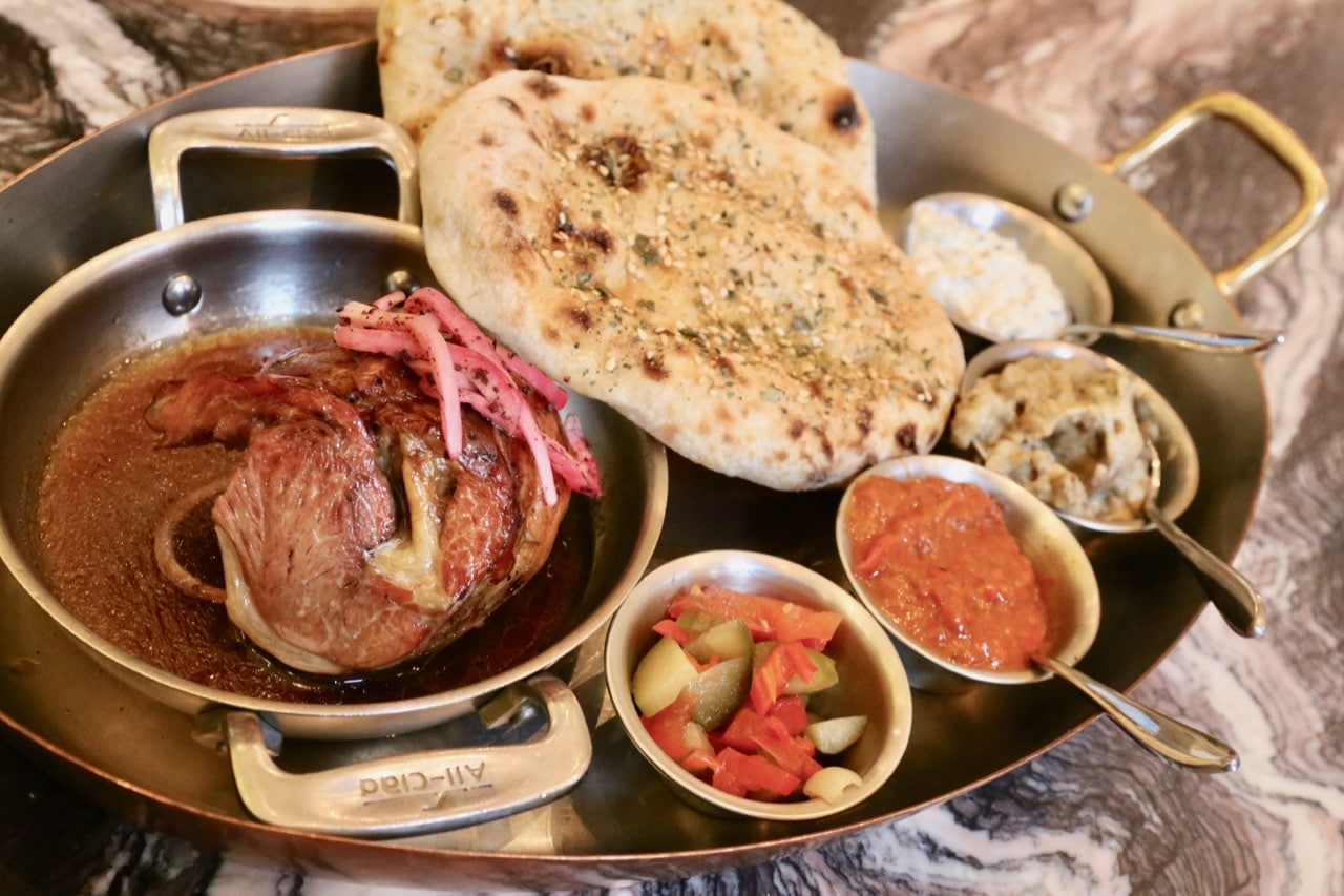 Estia Toronto's Lamb Shoulder is served with muhammara and tzatizki.