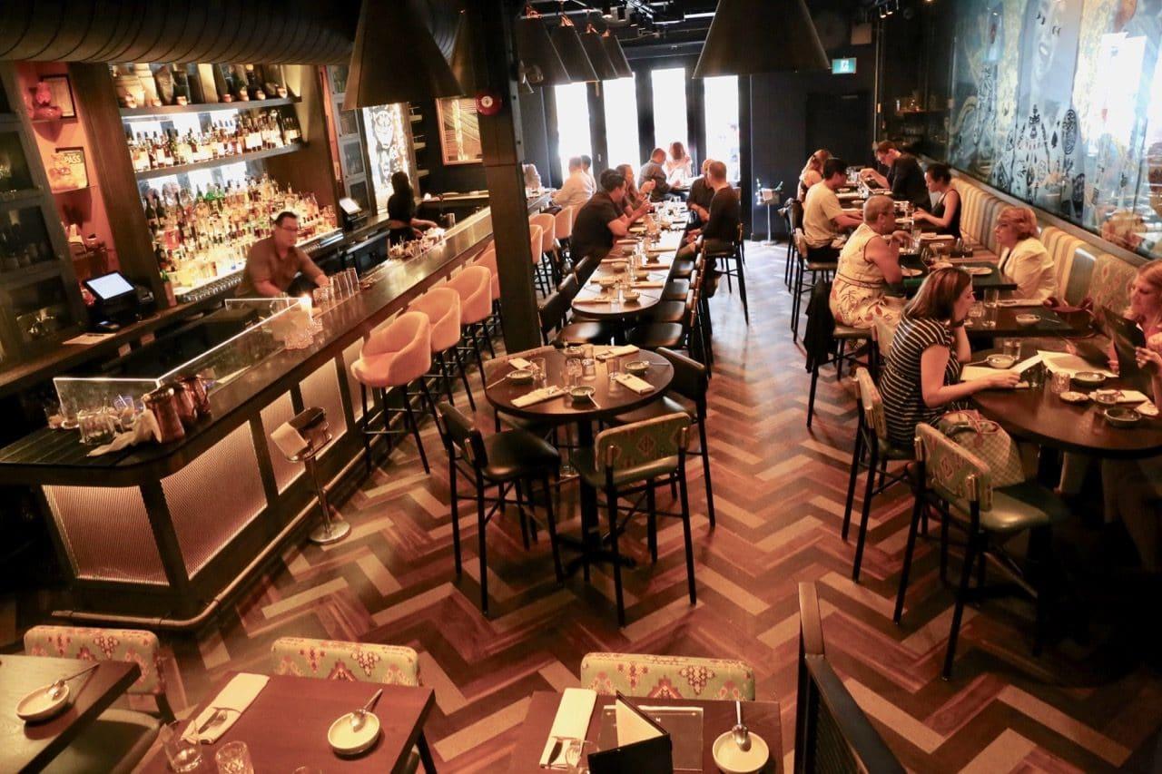 The dining room and bar at Mira Toronto.